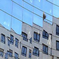 The reflected image of the top of a Parisian building, with its windows and its terrace, that is changed in a series of steps (Paris, 2007).<br /> <br /> L'immagine riflessa della cima di un edificio Parigino, con le sue finestre e la sua terrazza, che è trasformata in una serie di gradini (Parigi, 2007)