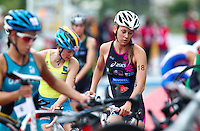17 SEP 2011 - LA BAULE, FRA - Inna Tsyganok (Stade Poitevin Tri) racks her bike in transition before the start of the run during the final round of the women's French Grand Prix Series at the Triathlon Audencia in La Baule, France (PHOTO (C) NIGEL FARROW)
