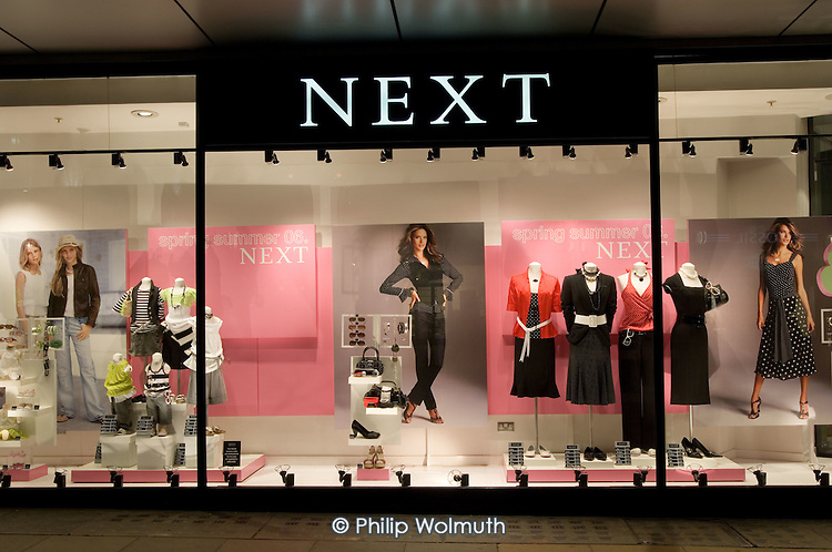 Next store on Oxford Street, central London, at night.
