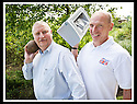 07/07/2010   Copyright  Pic : James Stewart.001_big_fish_printer  .::  GORDON BENNIE, MD OF BIG FISH, SWAPS THE SHOT PUTT FOR A PRINTER WITH BRITISH MASTER DECATHLETE KEN MONCRIEFF WHOSE COMPANY THE INFINITE GROUP WON THE PRINTER IN A PRIZE DRAW AT THE RECENT FALKIRK BUSINESS FAIR ::