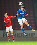 St Johnstone v Ross County....29.11.14   Scottish Cup 4th Round<br /> Brian Easton gets above Michael Gardyne<br /> Picture by Graeme Hart.<br /> Copyright Perthshire Picture Agency<br /> Tel: 01738 623350  Mobile: 07990 594431