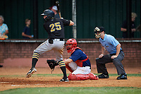 Elizabethton Twins catcher Trevor Casanova (33) awaits the pitch in front of home plate umpire Adam Pierce as Conner Uselton (25) bats during a game against the Bristol Pirates on July 29, 2018 at Joe O'Brien Field in Elizabethton, Tennessee.  Bristol defeated Elizabethton 7-4.  (Mike Janes/Four Seam Images)
