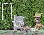 Outdoor Furniture used as planters, Oregon Gardens.  Oregon Gardens, Silverton, Oregon, USA, an 80 acre botanical garden in the Willamette Valley.  Outdoor livingroom.