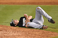 San Antonio Missions pitcher Devin Jones (55) lays on the ground in pain after being hit by a line drive during a game against the Arkansas Travelers on May 24, 2014 at Dickey-Stephens Park in Little Rock, Arkansas.  Arkansas defeated San Antonio 4-2.  (Mike Janes/Four Seam Images)