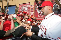 Albert Pujols (5) of the Los Angeles Angels signs autographs at press conference introducing him as a new member of the Angels at Angel Stadium on December 10, 2011 in Anaheim,California.(Larry Goren/Four Seam Images)