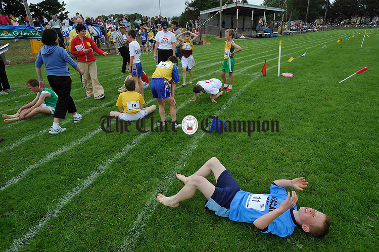 A competitor feels the pain after his race at the Clare Community Games Athletics finals in Rosslevan. Photograph by John Kelly.