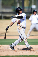 Chicago White Sox minor league infielder Micah Johnson #14 hits a triple during an instructional league game against the Los Angeles Dodgers at the Camelback Training Complex on October 9, 2012 in Glendale, Arizona.  (Mike Janes/Four Seam Images)