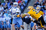 Face-Off Classic: Midfielder Brian Patton #31 of the UMBC Retrievers  checks Midfielder Marshall Burkhart #28 Hopkins during the UMBC v Johns Hopkins mens lacrosse game at M&T Bank Stadium on March 10, 2012 in Baltimore, Maryland. (Ryan Lasek/ Eclipse Sportswire)