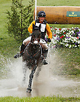 LEXINGTON, KY - APRIL 30: #43 Fernhill Cubalawn and Phillip Dutton compete in the Cross Country Test for the Rolex Kentucky 3-Day Event at the Kentucky Horse Park.  April 30, 2016 in Lexington, Kentucky. (Photo by Candice Chavez/Eclipse Sportswire/Getty Images)