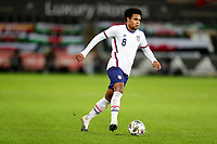 SWANSEA, WALES - NOVEMBER 12: Weston McKennie #8 of the United States runs with the ball during a game between Wales and USMNT at Liberty Stadium on November 12, 2020 in Swansea, Wales.