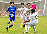 WOODBURY, CT-111120JS19 —Nonnewaug's Eli Brochu (16) settles the ball between Wolcott Tech's Luis Sanchez (8) and David Sanchez (12) during their game Wednesday at Nonnewaug High School. <br /> Jim Shannon Republican-American