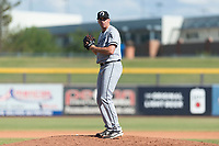 Glendale Desert Dogs relief pitcher Zach Thompson (49), of the Chicago White Sox organization, gets ready to deliver a pitch during an Arizona Fall League game against the Peoria Javelinas at Peoria Sports Complex on October 22, 2018 in Peoria, Arizona. Glendale defeated Peoria 6-2. (Zachary Lucy/Four Seam Images)