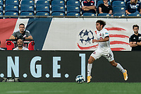 FOXBOROUGH, MA - JULY 23: Kobe Franklin #58 of Toronto FC II brings the ball forward during a game between Toronto FC II and New England Revolution II at Gillette Stadium on July 23, 2021 in Foxborough, Massachusetts.
