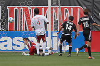 DC United midfielder Ben Olsen (14) shoots the ball to score the second goal against New York Red Bulls goalkeeper Ronald Waterreus in the 72nd minute. Ben Olsen scored the first hat trick of his career against the NY Red Bulls. DC United defeated the New York Red Bulls, 4-2, at RFK Stadium in Washington DC, Sunday, June 10 , 2007.
