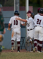 Braden River Pirates Nick Kemker (13) greets Trenton Hedgepeth (10) at the dugout after scoring a run during a game against the Venice Indians on February 25, 2021 at Braden River High School in Bradenton, Florida. (Mike Janes/Four Seam Images)