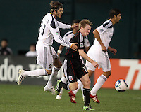 Dax McCarty (10) of D.C. United shields the ball from David Beckham (23) of the Los Angeles Galaxy during an MLS match at RFK Stadium, on April 9 2011, in Washington D.C.The game ended in a 1-1 tie.