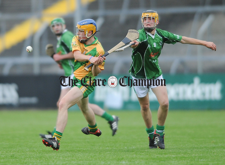 Ciaran Cooney of O Callaghan's Mills in action against Michael Barrett of Scariff during their game in Cusack Park. Photograph by John Kelly.