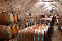 Domaine Cazeneuve in Lauret. Pic St Loup. Languedoc. Barrel cellar. France. Europe. Old vaulted stone cellar.