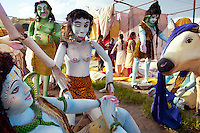 "India. Uttar Pradesh state. Allahabad. Maha Kumbh Mela. A group of women and various figures from hinduism, such as Shiva (L), the Demons (LC), Shiva (C) and the bull Nandi, inside the courtyard of a guru's ward. Shiva is a Hindu deity. He is ""the Destroyer"" or ""the Transformer""  of the universe among the Trimurti, the Hindu Trinity of the primary aspects of the divine. Nandi is the name for the bull which serves as the mount (Sanskrit: Vahana) of the god Shiva and as the gate keeper of Shiva in Hindu mythology. The Kumbh Mela, believed to be the largest religious gathering is held every 12 years on the banks of the 'Sangam'- the confluence of the holy rivers Ganga, Yamuna and the mythical Saraswati. The Maha (great) Kumbh Mela, which comes after 12 Purna Kumbh Mela, or 144 years, is always held at Allahabad. Uttar Pradesh (abbreviated U.P.) is a state located in northern India. 17.02.13 © 2013 Didier Ruef"
