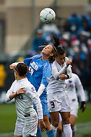 North Carolina forward Alyssa Rich (00) and Stanford defender Ali Riley (3) go up for the header. North Carolina defeated Stanford 1-0 to win the 2009 NCAA Women's College Cup at the Aggie Soccer Stadium in College Station, TX on December 6, 2009.