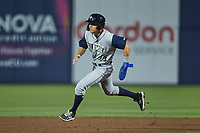 Darryl Collins (23) of the Columbia Fireflies hustles towards third base against the Kannapolis Cannon Ballers at Atrium Health Ballpark on May 18, 2021 in Kannapolis, North Carolina. (Brian Westerholt/Four Seam Images)