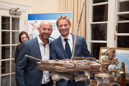 Richard Klabbers, Sevenstar's Managing Director (right) presents awards to Ian Walker whose record monohull run on VO 65 Azzam Abu Dhabi Ocean Racing of 4 days 13 hrs 10 mins 28 secs is the benchmark to beat in the 2022 race