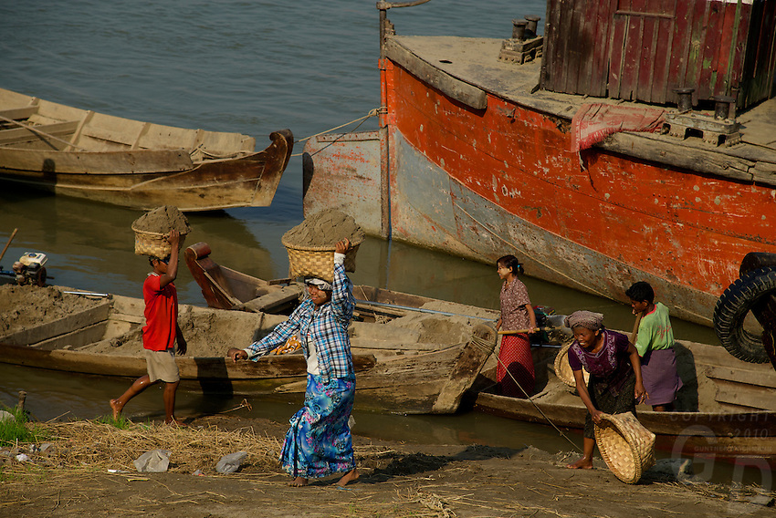 Women unlading sand, at the Ayeyarwaddy River side and Jetty Mandalay, Myanmar