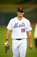 Scottsdale Scorpions Tim Tebow (15), of the New York Mets organization, during warmups before a game against the Salt River Rafters on October 12, 2016 at Scottsdale Stadium in Scottsdale, Arizona.  Salt River defeated Scottsdale 6-4.  (Mike Janes/Four Seam Images)