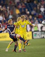 New England Revolution midfielder Pat Phelan (28) and Columbus Crew midfielder Kevin Burns (15) battle for the ball at midfield. The Columbus Crew defeated the New England Revolution, 1-0, at Gillette Stadium on October 10, 2009.