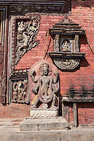 Nepal, Changu Narayan.  Hindu  Sculptures and Carvings Flanking Entrance to Temple.