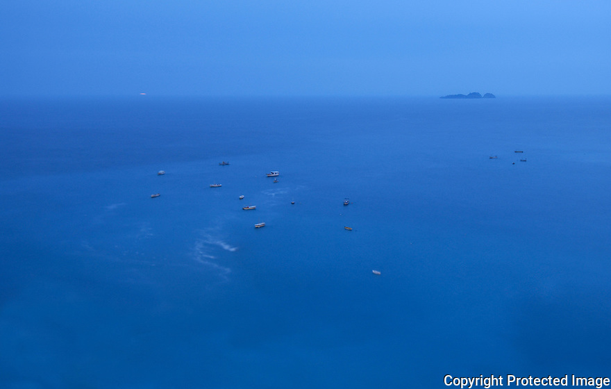 Boats anchored up just outside Positano on the Amalfi coast in Italy