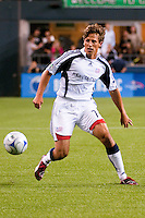 Wells Thopmpson (7) of the New England Revolution works the ball up the field against the Seattle Sounders in the match at the XBox Pitch at Quest Field on August 20, 2009. The Revolution defeated the Sounders 1-0.