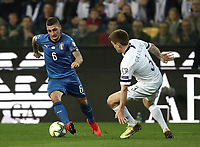 Football: Euro 2020 Group J qualifying football match Italy vs Finland at the Friuli Stadium in Udine on march  23, 2019<br /> Italy's Marco Verratti (l) in action with Finland's Albin Granlund (r) during the Euro 2020 qualifying football match between Italy and Finland at the Friuli Stadium in Udine, on march 23, 019<br /> UPDATE IMAGES PRESS/Isabella Bonotto