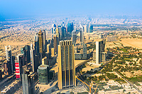 Aerial view of downtown skyscrapers in the Arabian desert from the height of Burj Khalifa in Dubai, United Arab Emirates, Asia