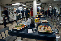 111003-N-DR144-046 PACIFIC OCEAN (Oct. 3, 2011) Full trays of food remain on the mess decks as Sailors aboard Nimitz-class aircraft carrier USS Carl Vinson (CVN 70) leave chow to man their battle stations during an unscheduled general quarters drill. The Carl Vinson Strike Group is underway conducting operations off the coast of Southern California.  U.S. Navy photo by Mass Communication Specialist 2nd Class James R. Evans (RELEASED).