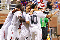 7 June 2011: USA Men's National Team forward Juan Agudelo (9) forward Jozy Altidore (17) defender Steve Cherundolo (6) and USA midfielder Landon Donovan (10) celebrate Jozy Altidore goal in the first half during the CONCACAF soccer match between Panama and Guadeloupe at Ford Field Detroit, Michigan.