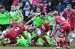 Scarlets hooker Ken Owens gets one hand on Munster fullback Felix Jones.<br /> Guiness Pro12<br /> Scarlets v Munster<br /> 21.02.15<br /> ©Steve Pope -SPORTINGWALES
