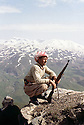 Iraq 1963 .A peshmerga with his gun  near the Iranian border.Irak 1963.Un peshmerga avec son fusil pres de la frontiere iranienne