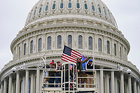 Trump supporters rally Wednesday, Jan. 6, 2021, at the Capitol in Washington. As Congress prepares to affirm President-elect Joe Biden's victory, thousands of people have gathered to show their support for President Donald Trump and his claims of election fraud. (AP Photo/John Minchillo)