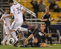 Conor Shanosky#17 of D.C. United tackles Mike Videira#34 of the Chicago Fire during a second round match of the Carolina Challenge on March 9 2011 at Blackbaud Stadium, in Charleston, South Carolina. D.C. United won 1-0.