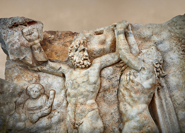 Close up of a Roman Sebasteion relief sculpture of Zeus and Prometheus, Aphrodisias Museum, Aphrodisias, Turkey.   Against an art background.<br /> <br /> Prometheus is screaming in pain. Zeus had given him a terrible punishment for giving fire to man: he was tied to the Caucasus mountains and had his liver picked out daily by an eagle. Herakles shot the eagle and is undoing the first manacle. He wears his trade mark lion-skin and thrown his club to one side. A small mountain nymph, holding a throwing stick appears amongst the rocks.