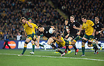 Dan Carter runs. All Blacks beat Australia 22-0. Eden Park, Auckland. 25 August 2012. Photo: Marc Weakley