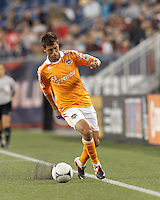 Second half substitute Houston Dynamo midfielder Colin Clark (7) controls the ball. In a Major League Soccer (MLS) match, the New England Revolution tied Houston Dynamo, 2-2, at Gillette Stadium on May 19, 2012.