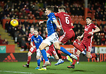 Aberdeen v St Johnstone…..05.02.20   Pittodrie   SPFL<br />Jason Kerr heads wide under pressure from Michael Devlin<br />Picture by Graeme Hart.<br />Copyright Perthshire Picture Agency<br />Tel: 01738 623350  Mobile: 07990 594431