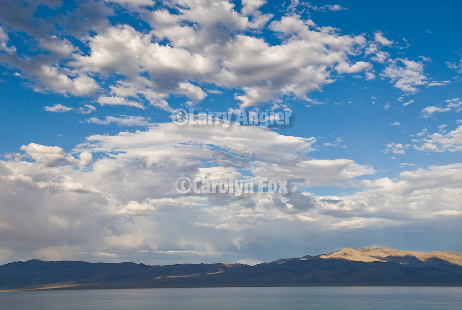 Clouds remain from forming summer storms over the Gillis Range on the east side of Walker Lake.