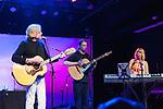 Justin Hayward, Mike Dawes, and Julie Regins perform at The Rose night club.
