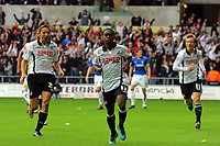 ATTENTION SPORTS PICTURE DESK<br /> Pictured: Nathan Dyer of Swansea (C) celebrating his opening goal with team mates Federico Bessone and Cedric Van der Gun.<br /> Re: Coca Cola Championship, Swansea City Football Club v Cardiff City FC at the Liberty Stadium, Swansea, south Wales. Saturday 07 November 2009
