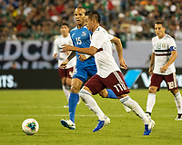 CHARLOTTE, NC - JUNE 23: Roberto Alvarado #11 attacks the goal during a game between Mexico and Martinique at Bank of America Stadium on June 23, 2019 in Charlotte, North Carolina.