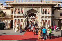Jaipur, Rajasthan, India. Tourists Entering and Exiting Jaipur City Palace, Prepared for a Wedding Reception later in the Afternoon.