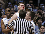 UNC's Tyler Hansbrough, bloodied after a flagrant foul by Duke's Gerald Henderson (not pictured), is held back by teammates (from left) Wayne Ellington and Dewey Burke immediately following the foul at the Smith Center on Sunday, March 4, 2007.  Henderson was ejected from the game.